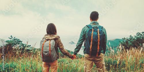 Traveler couple in love enjoying view of sea - 79538756