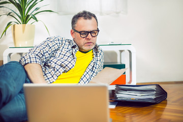 Shot of hipster businessman working on laptop. Selective focus
