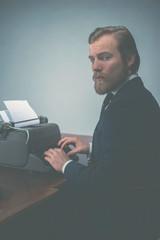 Handsome vintage journalist sitting working