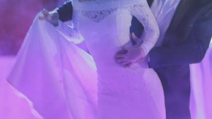 Newlyweds dancing their first wedding dance in a smoke