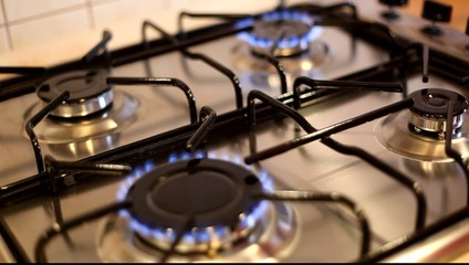 Gas burners are lit on a gas stove. HD video