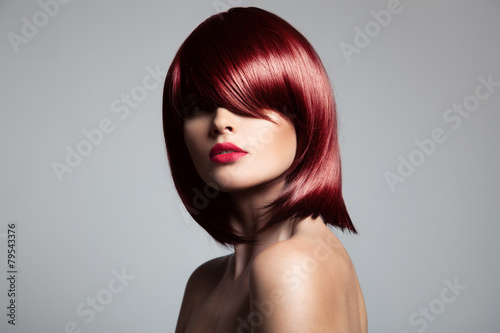obraz PCV Beautiful red hair model with perfect glossy hair. Close-up port