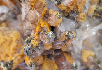 Mineral, yellow calcite and pyrite close up
