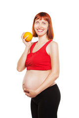 pregnant woman and orange.isolated on a white background