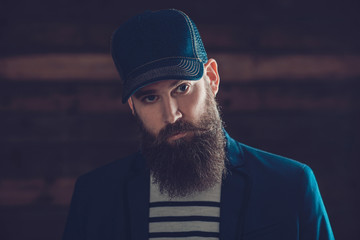 Man in Blue Cap with Long Beard and Mustache