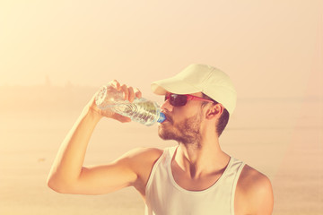 Thirsty after jogging/exercising near Danube river.