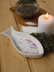 Salt,mud,candle and dry lavender on the wooden background