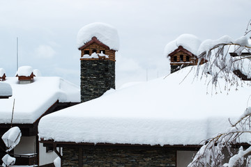 Snow covered chimney and roof