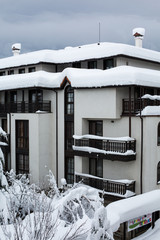 Snow covered chalets after the hard snowfall