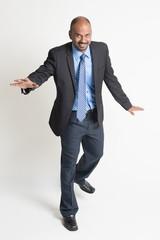 Indian businesspeople walking balance