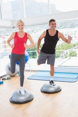 Fit couple working on bosu ball