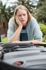Thoughtful woman looking at engine