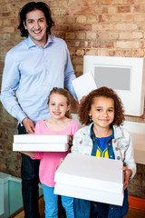 Kids with dad and pizza boxes