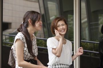 Two women on a walkway in Namba Park office and shopping complex.