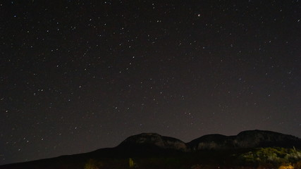Time lapse of stars and the milk way over smith rocks.