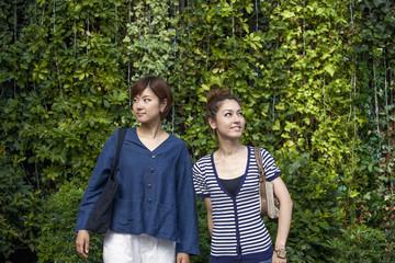 Two women standing side by side.