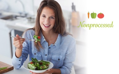 Nonprocessed against pretty woman eating a salad