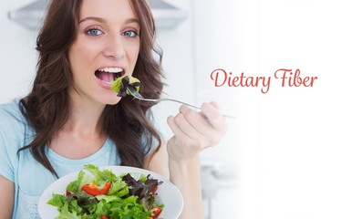 Dietary fiber against brunette eating healthy salad