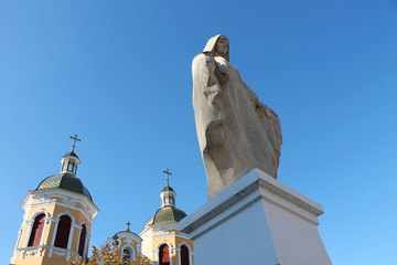 Statue of the Virgin Mary and Church
