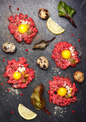 Beef tartare with egg, capers and onions. Top view. See series
