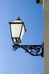 vintage streetlamp with blue sky in a background