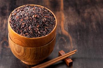 Wild brown rice and chopsticks