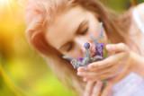 Fototapety Woman holding flowers