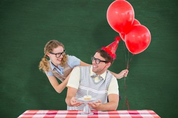 Geeky hipster couple celebrating birthday