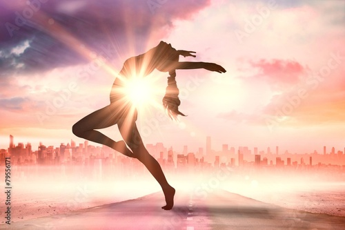 Composite image of side view of a sporty young woman stretching - 79556171
