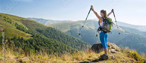 Young woman hiking in the mountains - 79556195