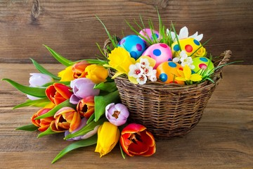 Basket with Easter eggs and tulips