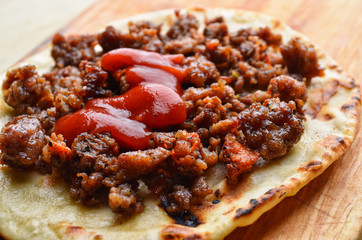 Mexican cuisine. Fried tortilla with meat.