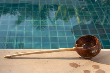 Coconut shell dipper at spa pool
