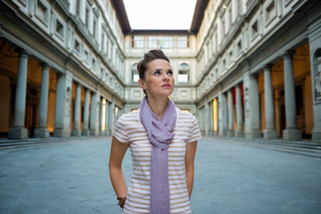 Portrait of young woman near uffizi gallery in florence, italy