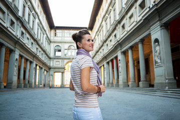 Young woman standing near uffizi gallery in florence, italy