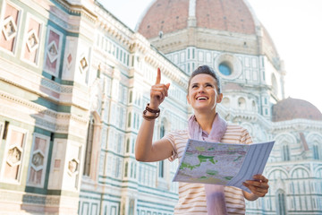 Young woman with map in front of cattedrale  in firenze