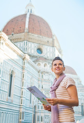 Portrait of happy woman with map near cattedrale in firenze