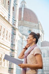 Young woman with map and audio guide in firenze