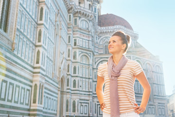Happy young woman standing in front of cattedrale in firenze