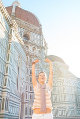 Portrait of happy young woman rejoicing in firenze