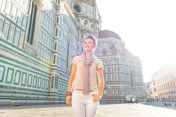 Happy young woman in front of cattedrale in firenze