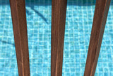 Swimming pool wooden fence closeup