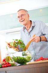 Mature man in the kitchen prepare salad III