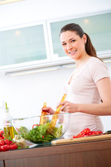 Young woman in the kitchen prepare salad IX