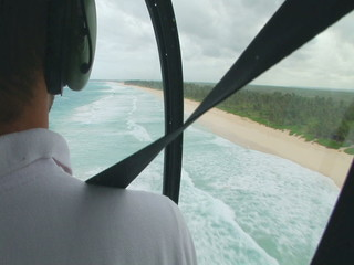 A helicopter in flight. A pilot navigates a helicopter over the jungle.