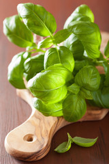 fresh basil leaves herb on wooden background
