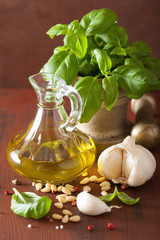 ingredients for pesto sauce over wooden rustic background