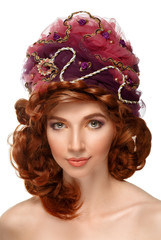 Beautiful red-haired girl in a headdress.