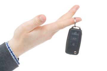 Male hand giving car keys - studio shot on white