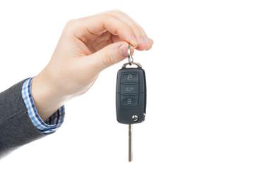 Male hand giving car keys - studio shot on white background